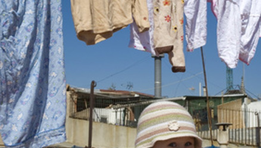 Homemade wooden clothesline props help make air-drying clothes an easy task.