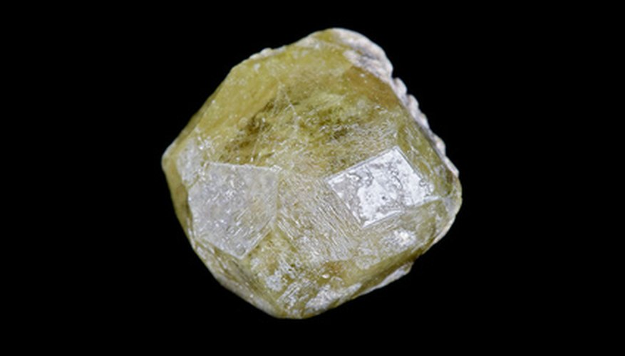 Unless you are well-trained, the best way to identify an uncut diamond is to take it to a jeweller.