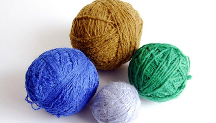 Turn yarn into hand knit flat-top hats.