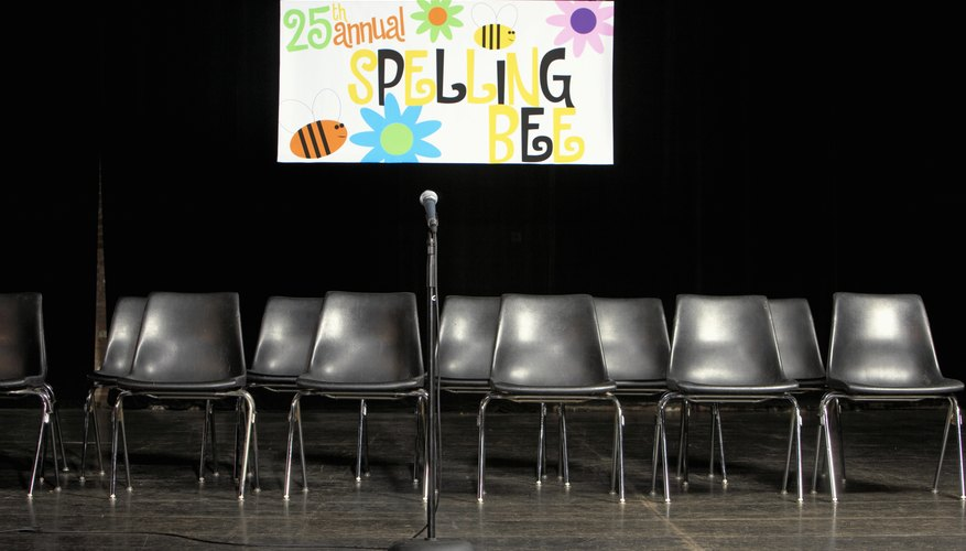 A stage is set up for a spelling bee competition.