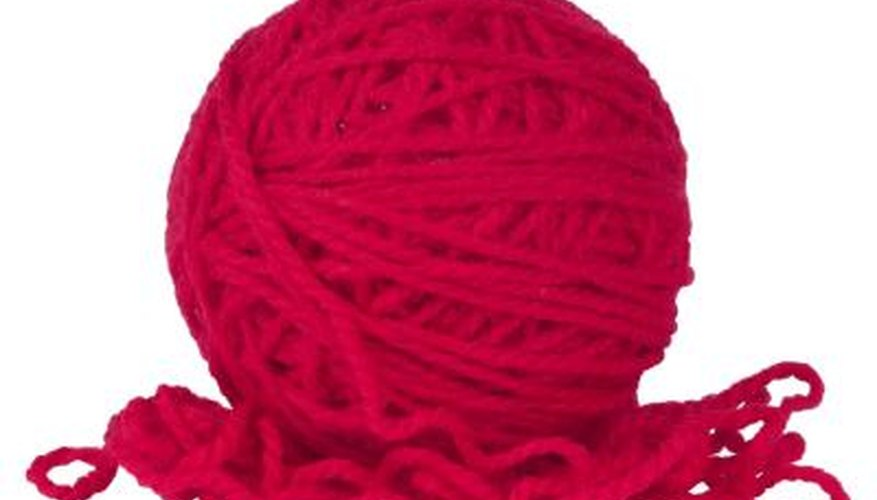 Worsted weight yarn is used to knit a winter nose warmer.