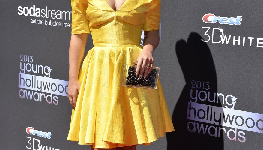 Kelly Osborne's fit-and-flare dress gives her the appearance of a perfectly proportioned figure.