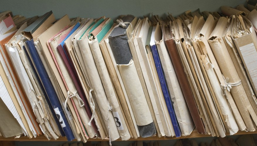 A close-up of a shelf of archived paperwork.