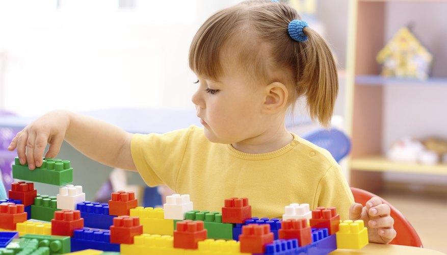 Toys that preschoolers assemble, like Lego blocks, help develop fine motor skills.