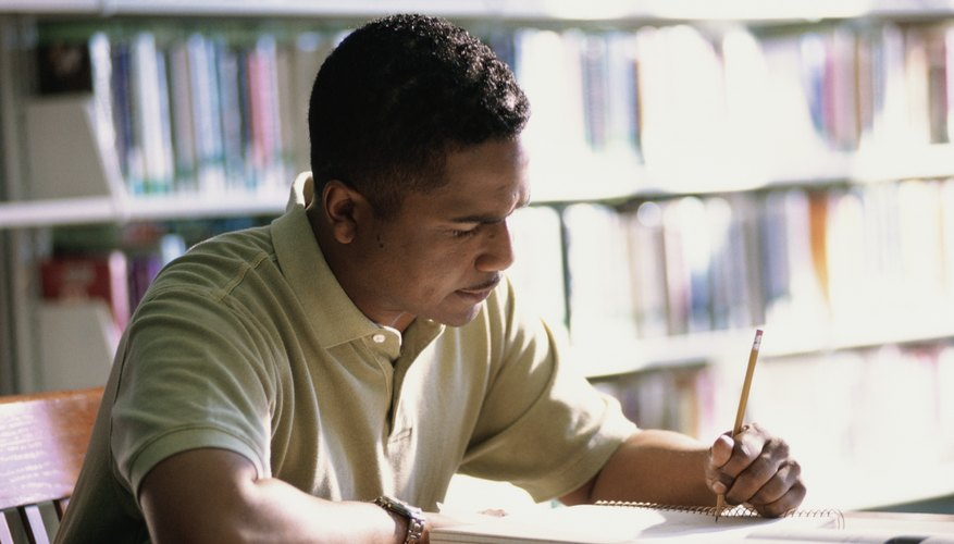 Man studying at a library.