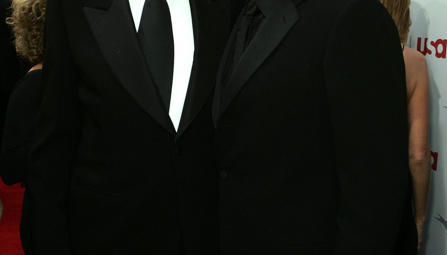 Get the neat Sean Connery look by catering perfecting your tuxedo shirt collar.