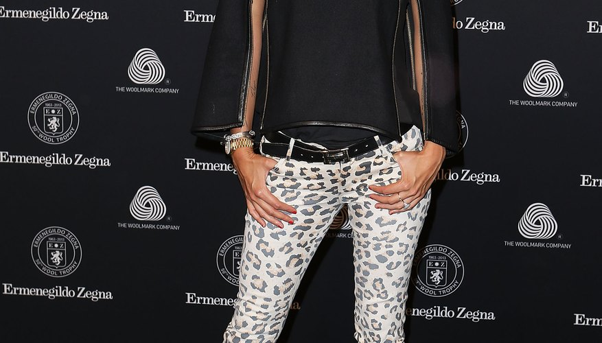 Model Cheyenne Tozzi rocks leopard print jeans, keeping it neutral and simple up top so she looks refined, not like she's playing