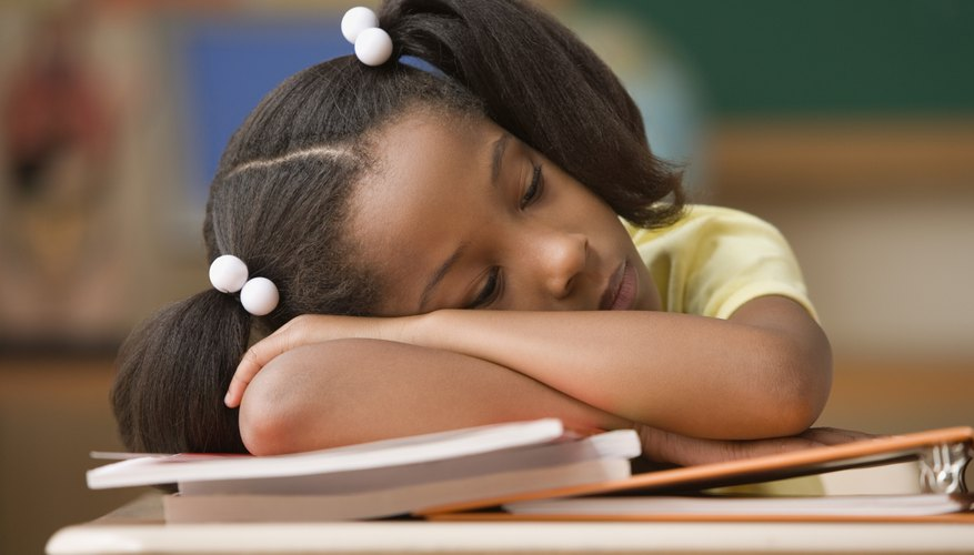 A long school day can lead to sleepiness and fatigue.