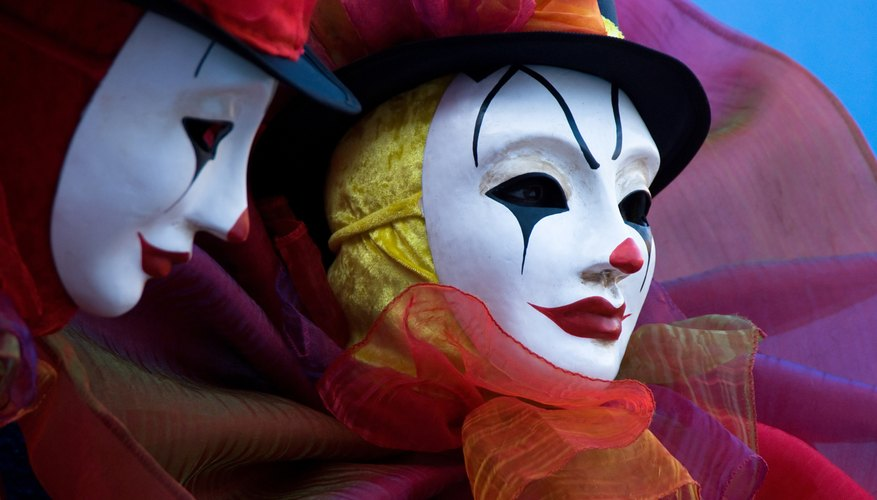 Close-up of men in harlequin costume