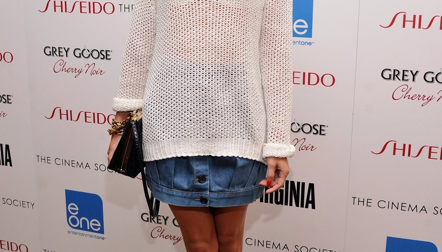Wear a button-front denim skirt with a sheer white sweater like fashion expert Olivia Palermo.