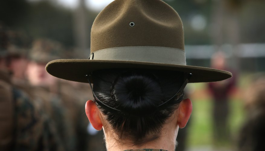 Female Marine Corp Drill Sargent with recruits during boot camp training
