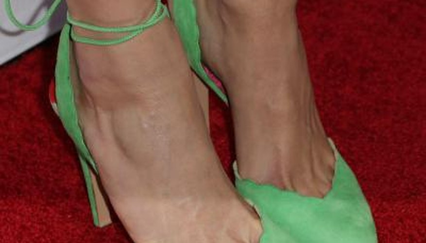 Suede shoes like Emmy Rossum's are lovely, but they're not waterproof.