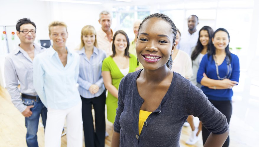 Colleagues of different cultures working productively together may be one benefit of cultural pluralism.