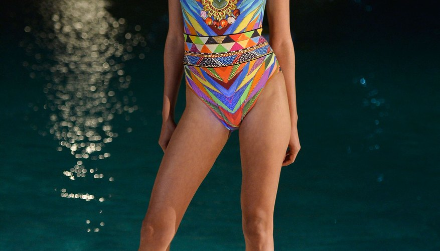 A model in a Gottex fashion show wears a colorful one-piece swimsuit.