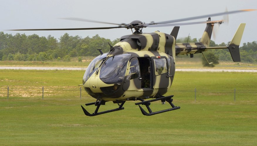Military helicopter landing on airfield