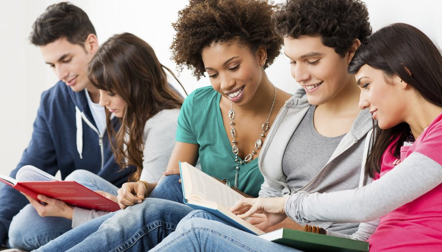 MBA candidates look through text books together