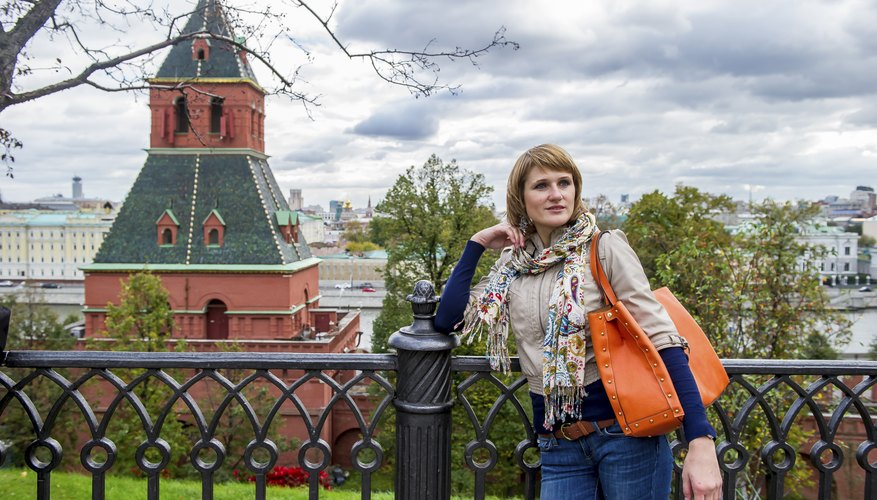 A stylish modern Russian woman standing in front of a building.