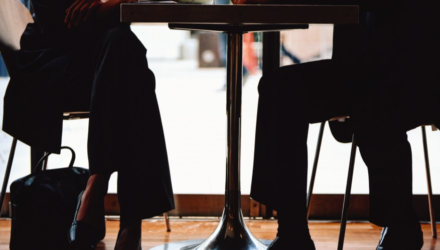 Legs of man and woman sitting in cafe