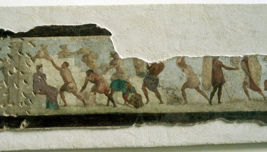 A mural fragment shows slaves building a wall in ancient Rome