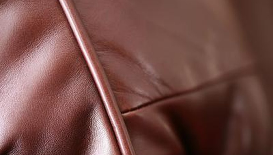 Repair a sun damaged leather sofa with specially made leather dye.