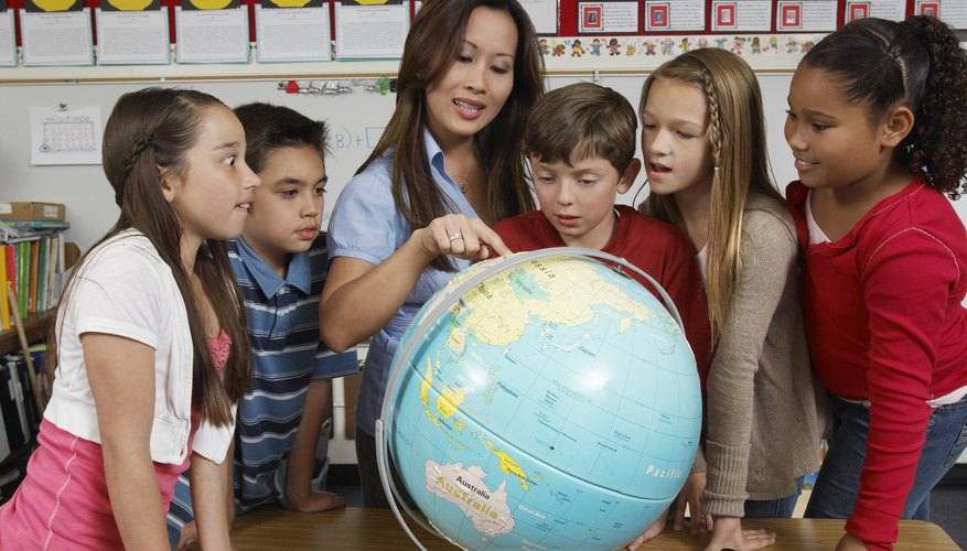 Children standing during a geography lesson.