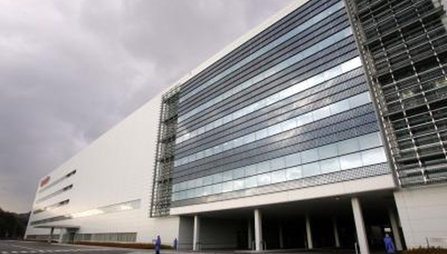 Solar panels on building walls generate electricity for the building.
