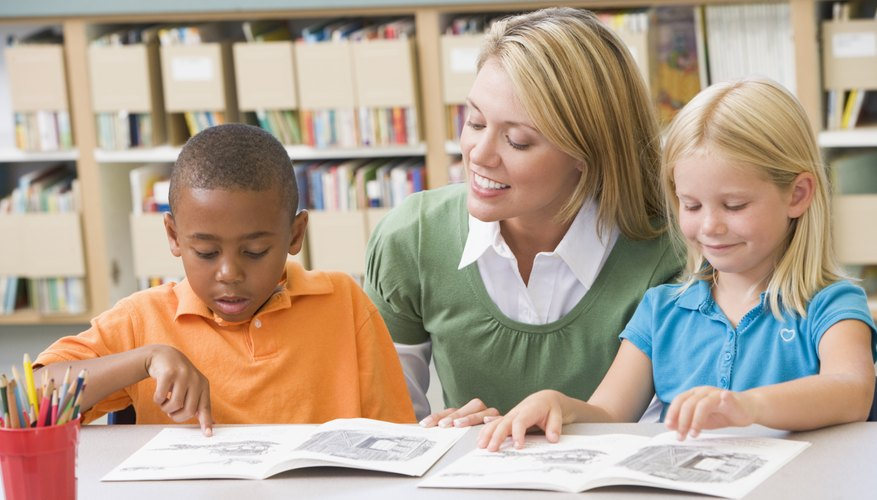 Teacher reading with young students in the library.