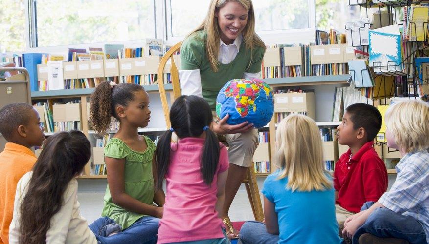Kindergarten teacher showing globe to class.