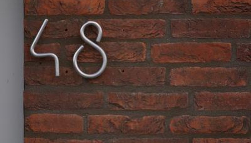 Install house numbers on brick without masonry anchors using Gorilla Glue.