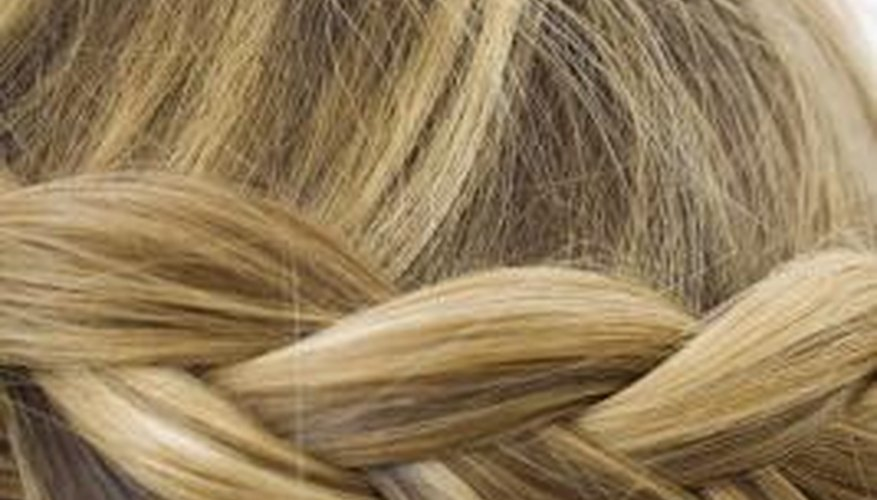 Create a classic french braid in a few easy steps with the Scunci Easy Braid.