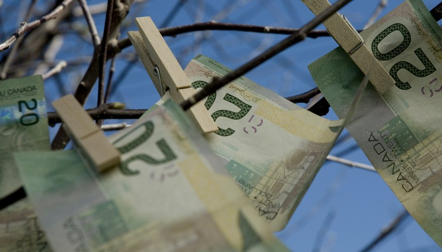 Place an small undecorated Christmas tree on a table and encourage people to pin money to the tree.