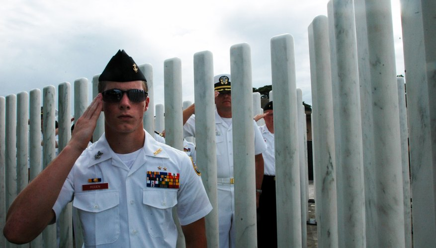 ROTC cadet salutes during ceremony at the USS Oklahoma Memorial in Pearl Harbor, Hawaii