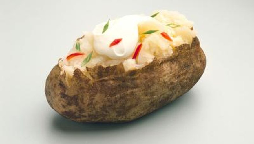 Top baked potatoes sour cream or your favourite toppings.