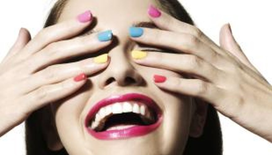 Let your polished nails dry thoroughly between coats to prevent smudging.