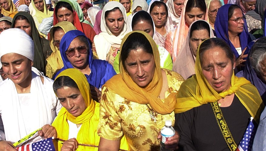 Sikh women, wearing traditional garb, practice a religion born in the 1500s.
