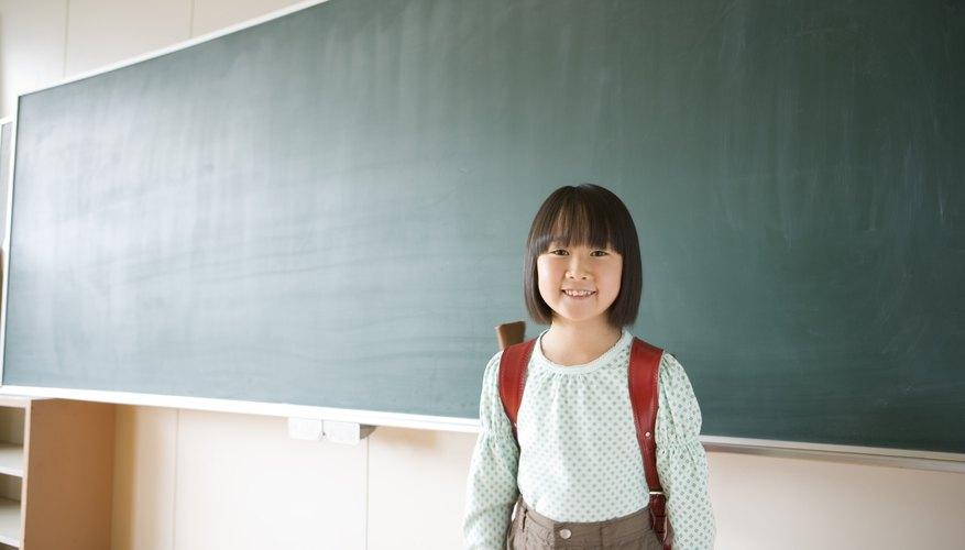 Smiling young child in classroom.