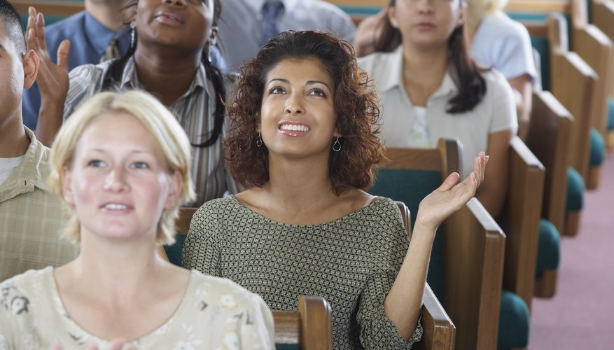 Pentecostals often clap and raise their hands during worship.