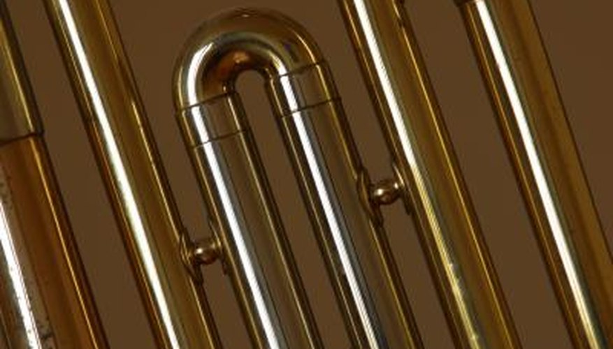 Brass is a shiny yellow metal that may sometimes be mistaken for gold. Some objects are plated with brass, while others are made of solid brass.