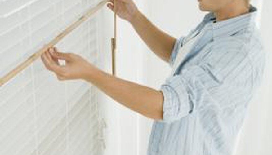 Use special fittings to attach blinds to uPVC window frames.