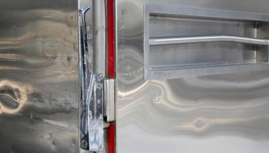 Moving a freezer on its side requires taking some precautions to prevent damage.