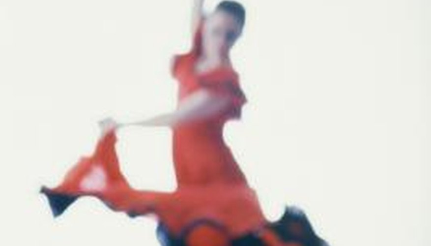 Flamenco dancers exhibit grace and physical control.