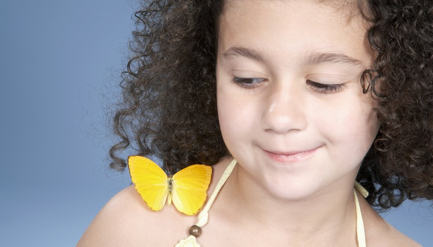 Young girl with butterfly.