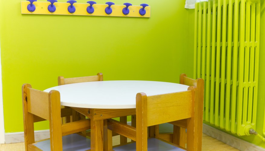 A small seating area near coat hooks in a child's classroom.