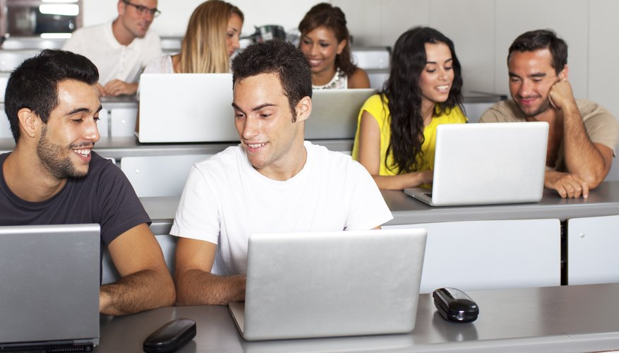 College students in class with their laptops
