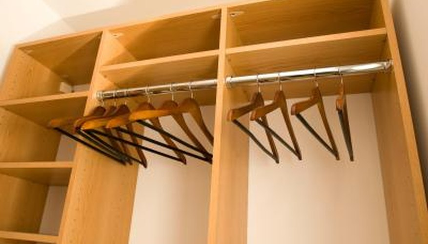 Wardrobe shelves give extra storage space.
