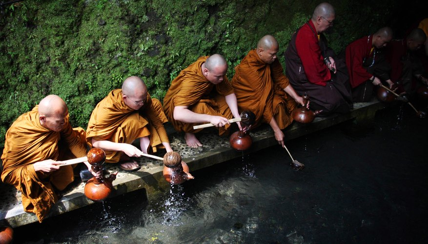 Buddhist monks collect water, which plays a symbolic role in certain funeral rituals.