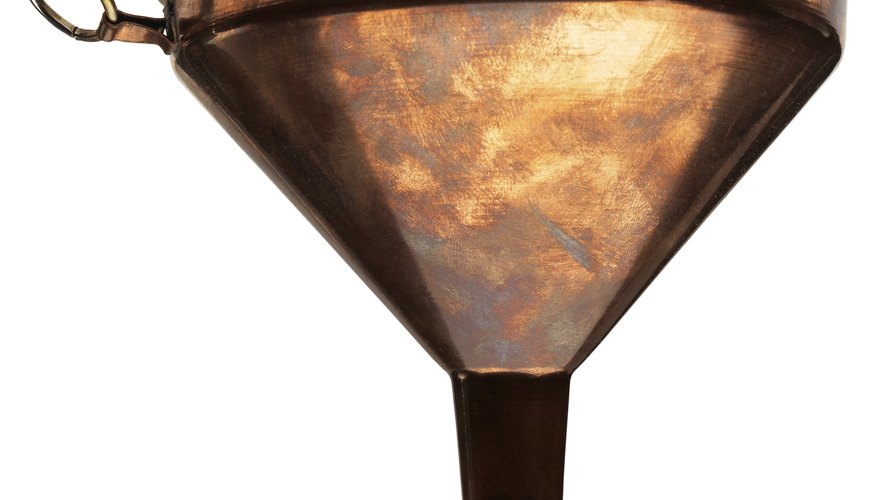 Metal funnel for oil.