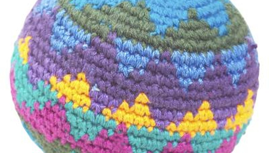 Knit a large ball to use up scraps; it makes a fun and functional pillow!