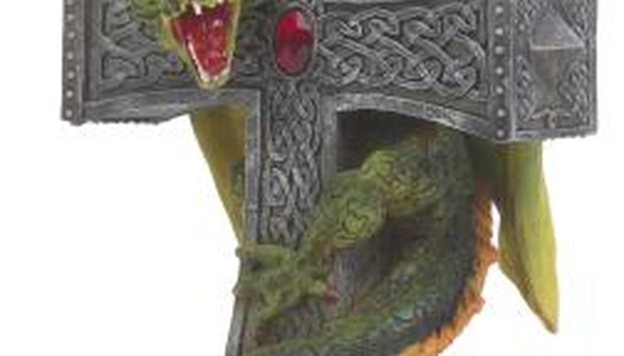Pewter miniatures and models are painted to provide detail.