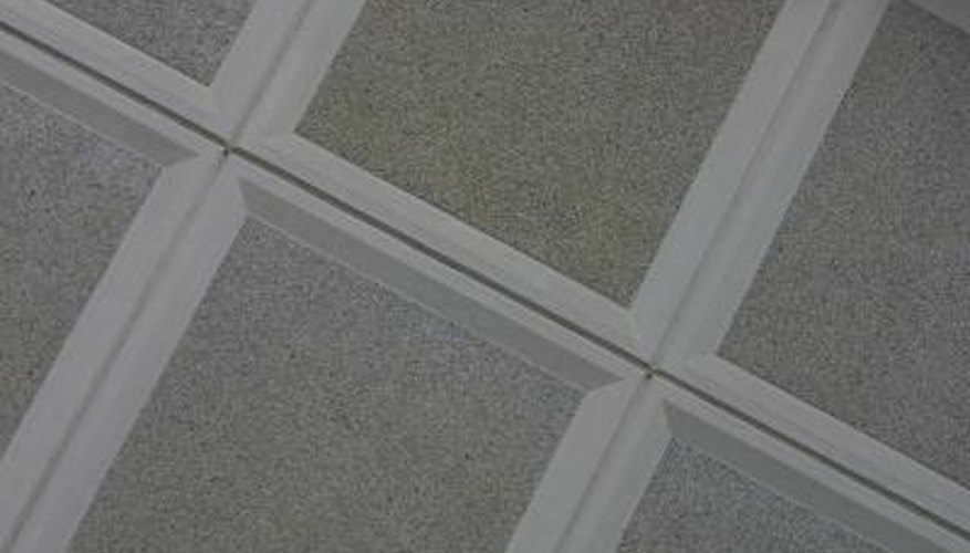 Suspended ceilings hang below joists and leave a gap at stairways.